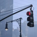 Free stock photo Road signal and street light against office building in city