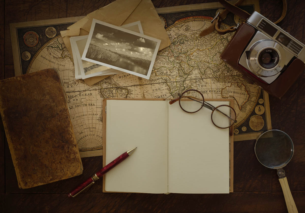 Antique world map with travel journal photographs and vintage free stock photo antique world map with travel journal photographs and vintage camera gumiabroncs Images