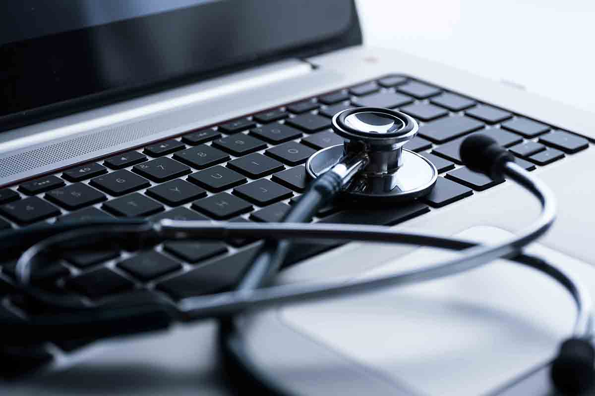 Free stock photo Close-up of stethoscope on laptop keyboard