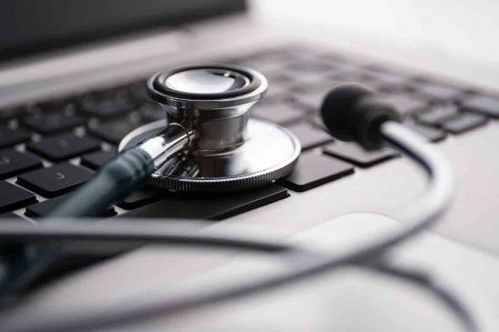 Free stock photo Close-up of stethoscope on laptop keyboard