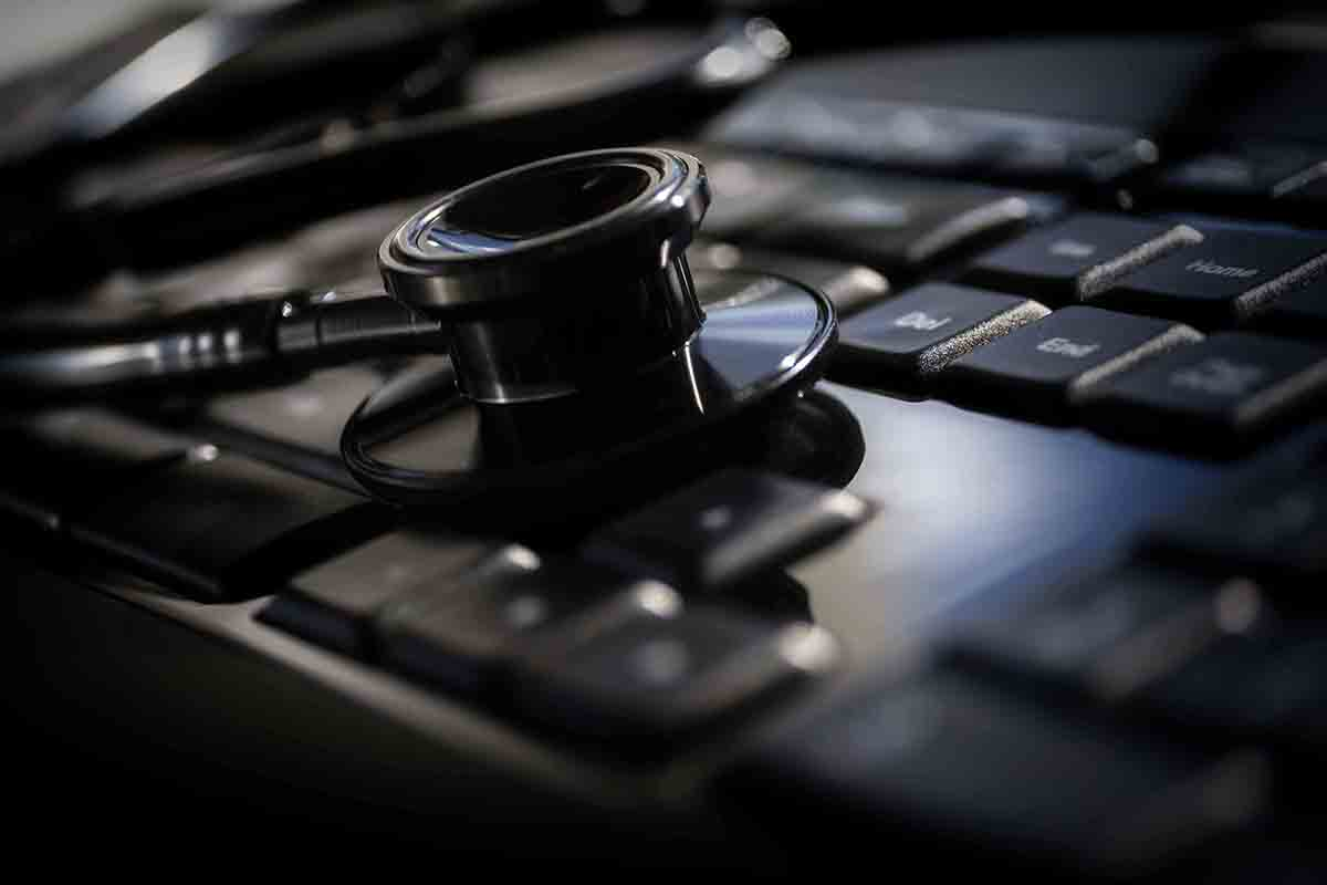 Free stock photo Close-up of stethoscope on computer keyboard