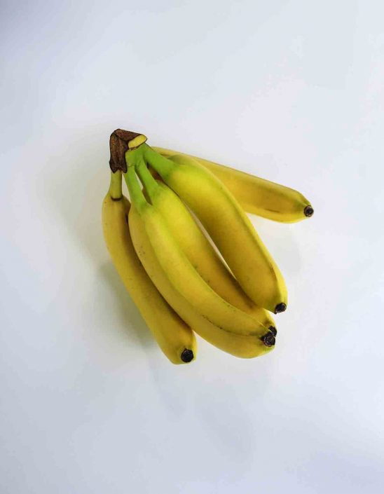 Free stock photo High angle view of bananas over white background