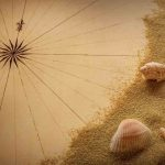 Free stock photo High angle view of compass rose with sand and seashells