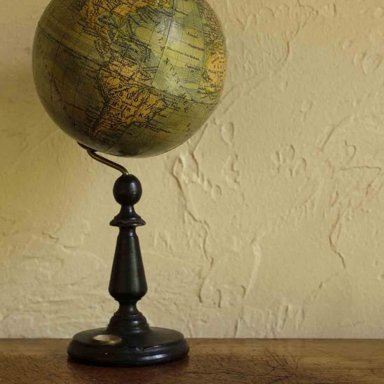 Free stock photo Antique globe on table against wall