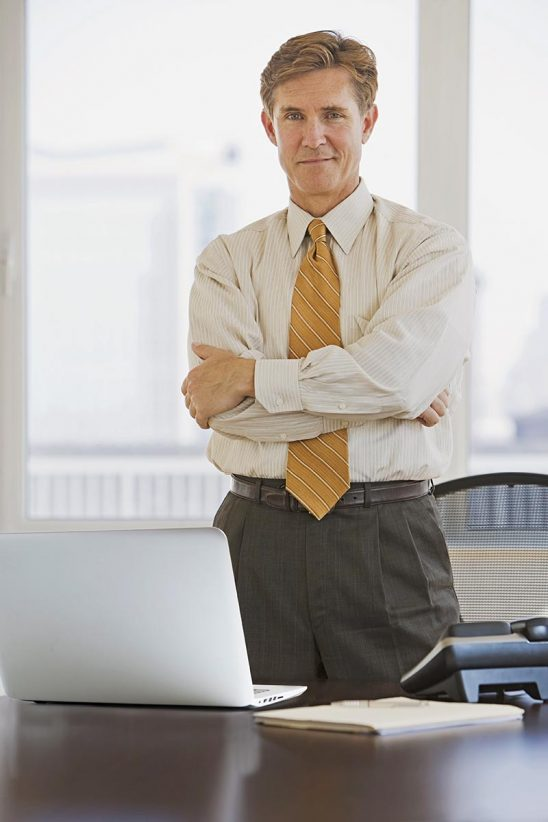 Free stock photo Business executive with crossed arms looking at camera