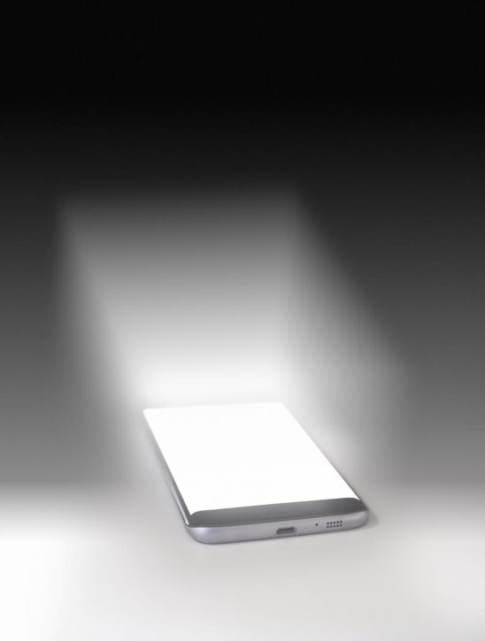 Free stock photo Mobile phone with glowing white screen