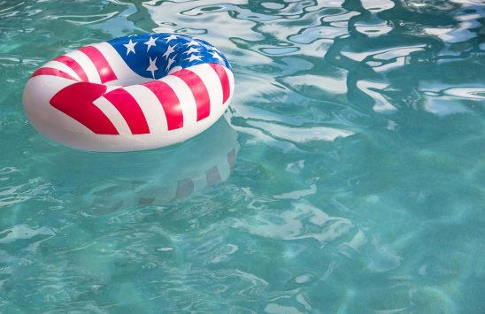 Free stock photo Float with American flag design in a swimming pool