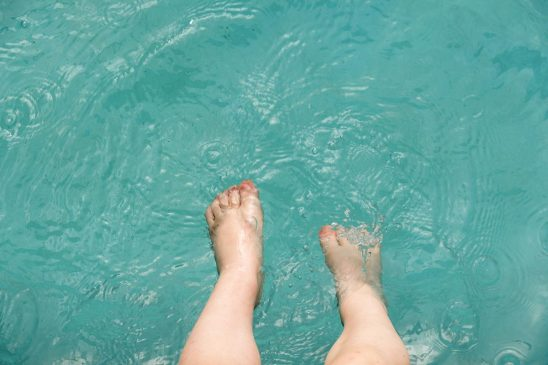Free stock photo Child's feet spashing in pool water