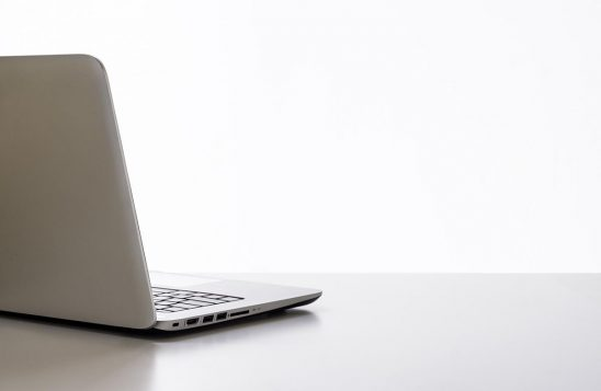 Free stock photo Open laptop computer on a white desk