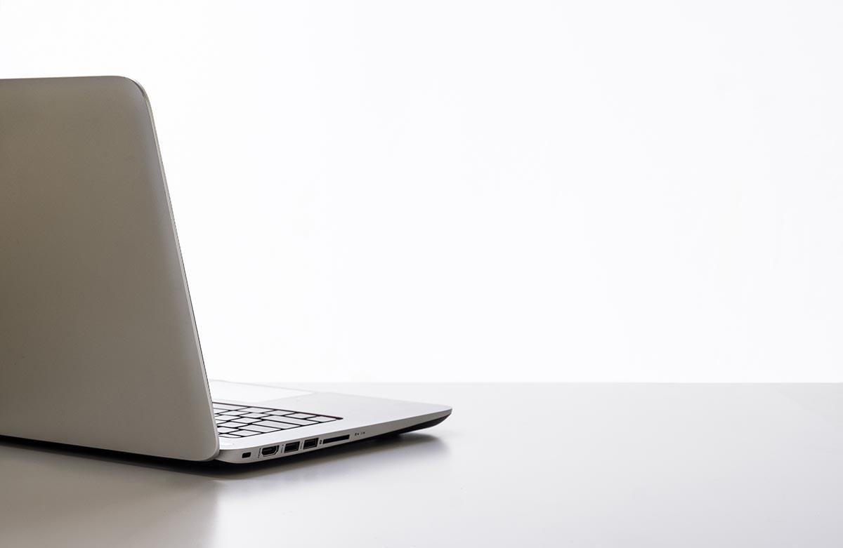 Free stock photo Open laptop computer on a white desk