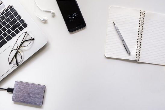 Free stock photo Laptop, cellphone, and phone on a white desk