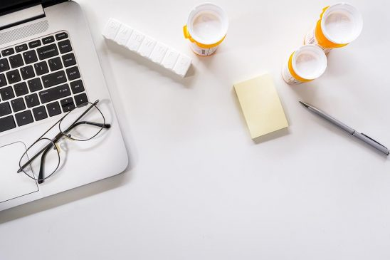 Free stock photo Laptop computer with pill bottles