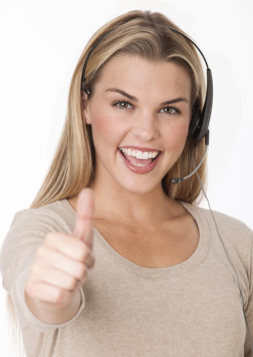 Free stock photo A young smiling woman wearing a headset and making a 'thumbs up'