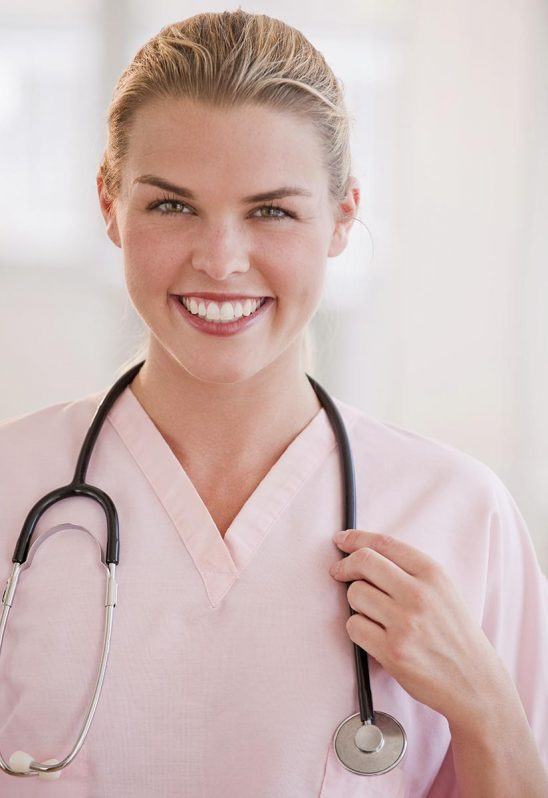 Free stock photo Female medical professional or doctor holding onto her stethoscope