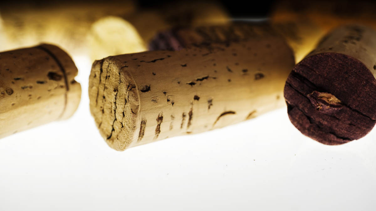 Free stock photo Background close-up of wine corks on white background
