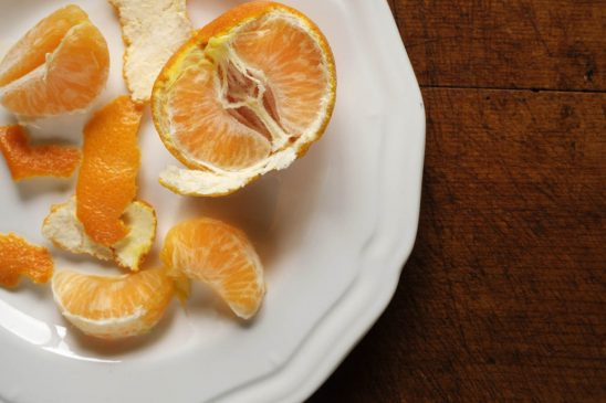 Free stock photo Close-up of peeled orange in plate on table