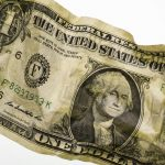 Free stock photo Close-up of crumpled one dollar bill on white background