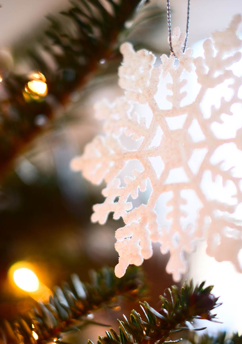 Free stock photo Close-up of snowflake ornament on Christmas tree