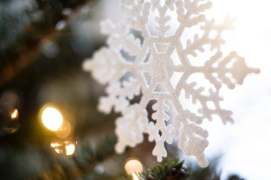 Free stock photo Snowflake ornament on Christmas tree