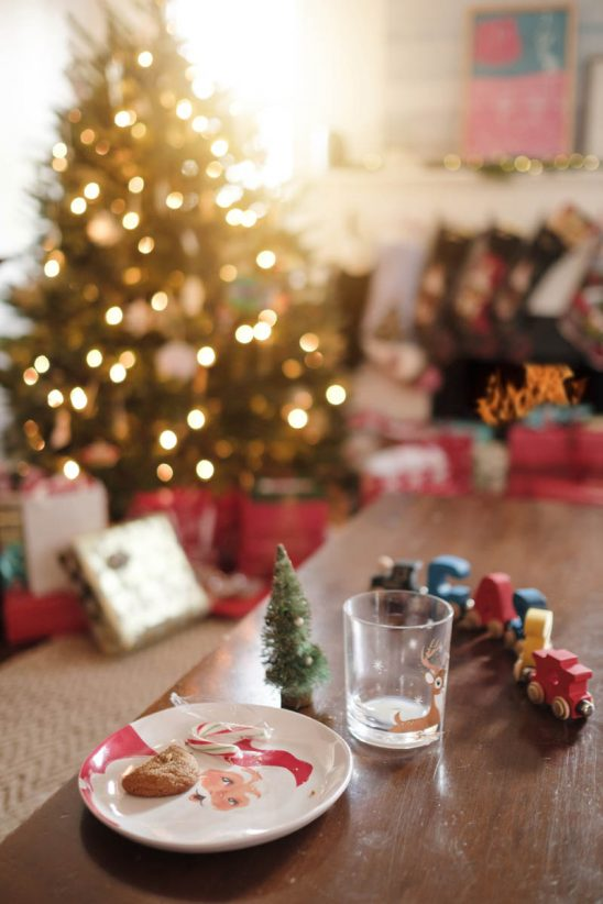 Free stock photo Decorated Christmas tree by gifts and stockings at home