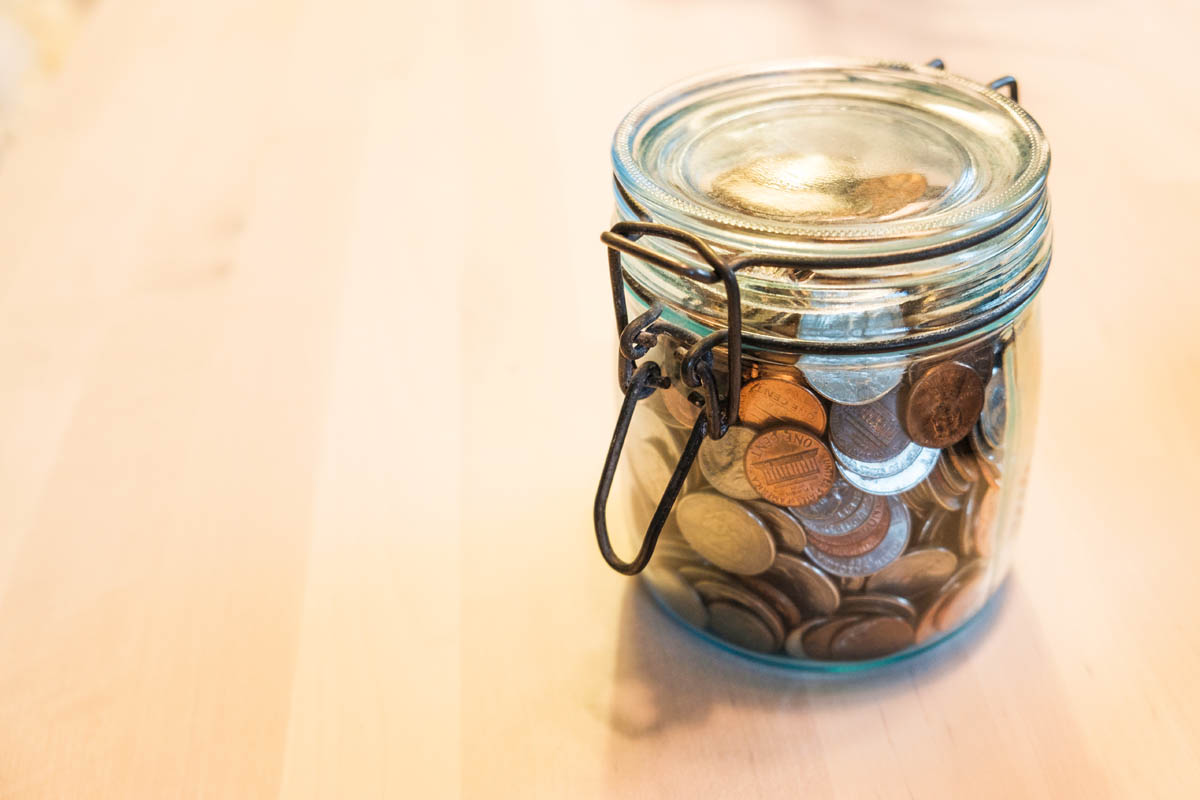 Free stock photo Close-up of coins in glass jar on table