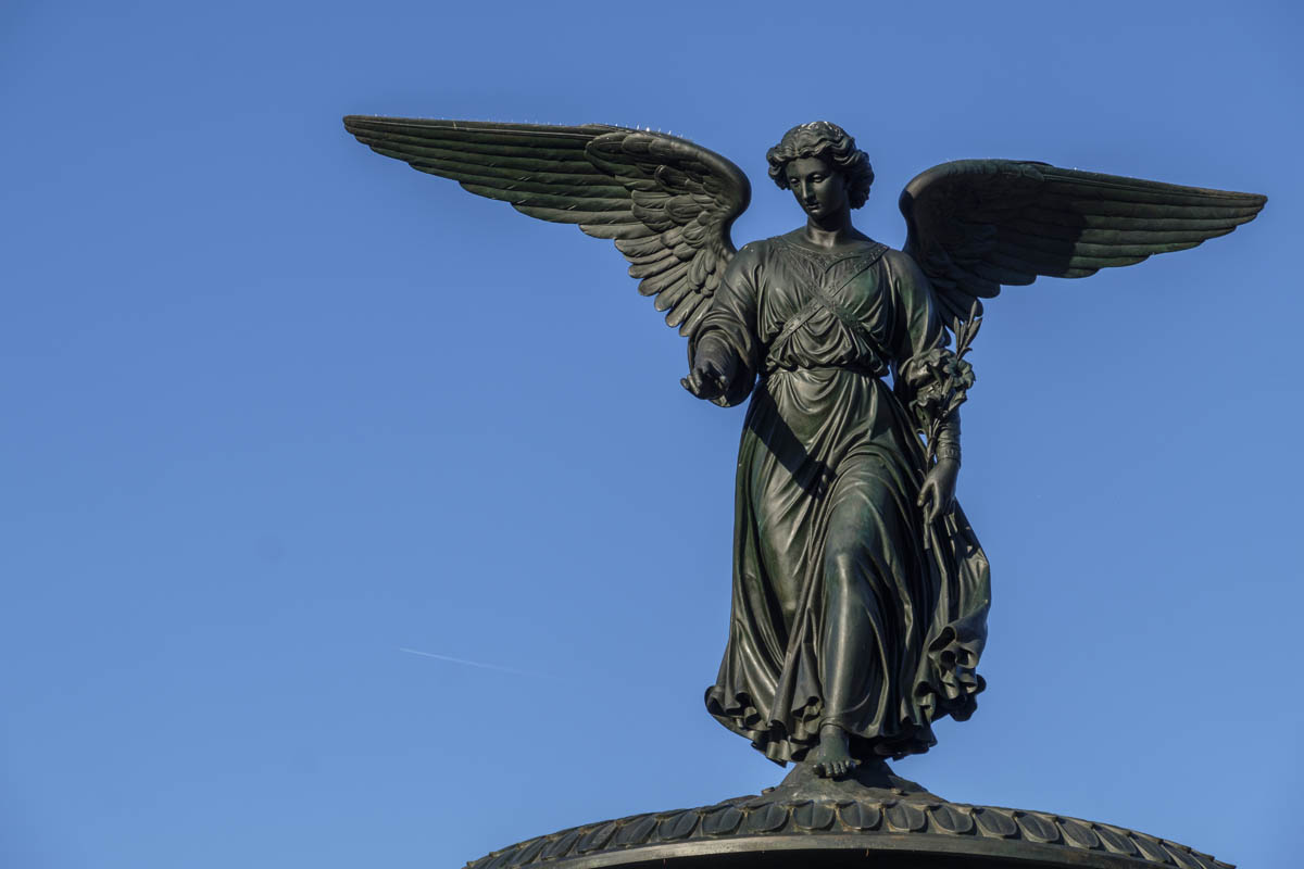 Free stock photo Angel statue on top of Bethesda Fountain against clear sky