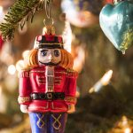 Free stock photo Close-up of nutcracker figurine on Christmas tree