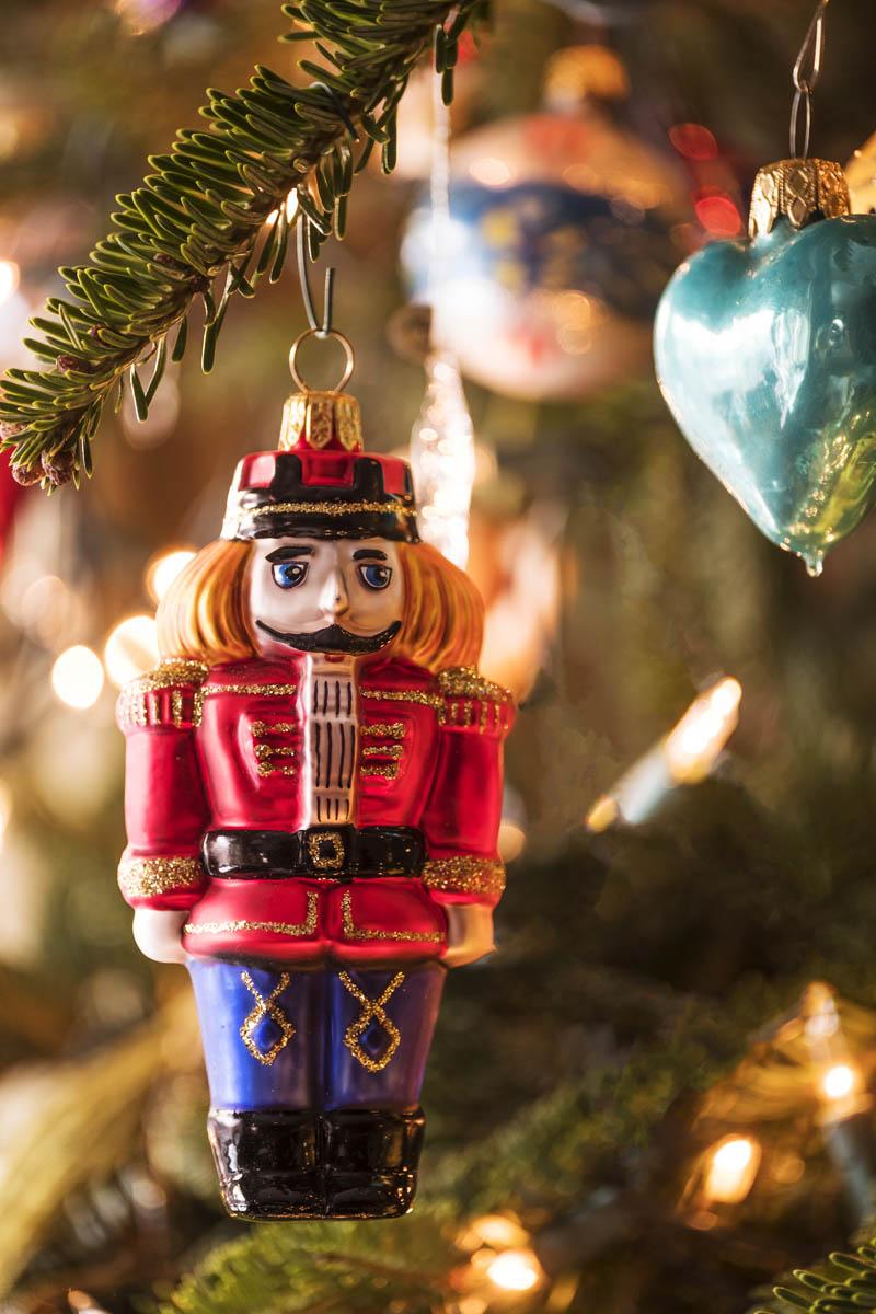 Free stock photo Close-up of nutcracker figurine on Christmas tree