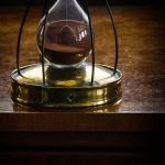 Free stock photo Close-up of hourglass on wooden table