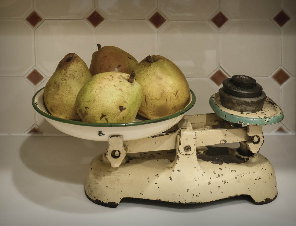 Free stock photo Close-up of pears on vintage weighing scale