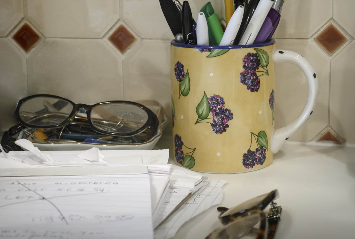 Free stock photo Desk organizer by documents and eyeglasses on kitchen counter