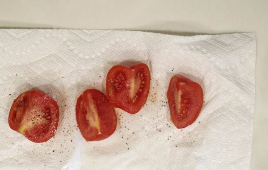 Free stock photo High angle view of black pepper on tomato slices