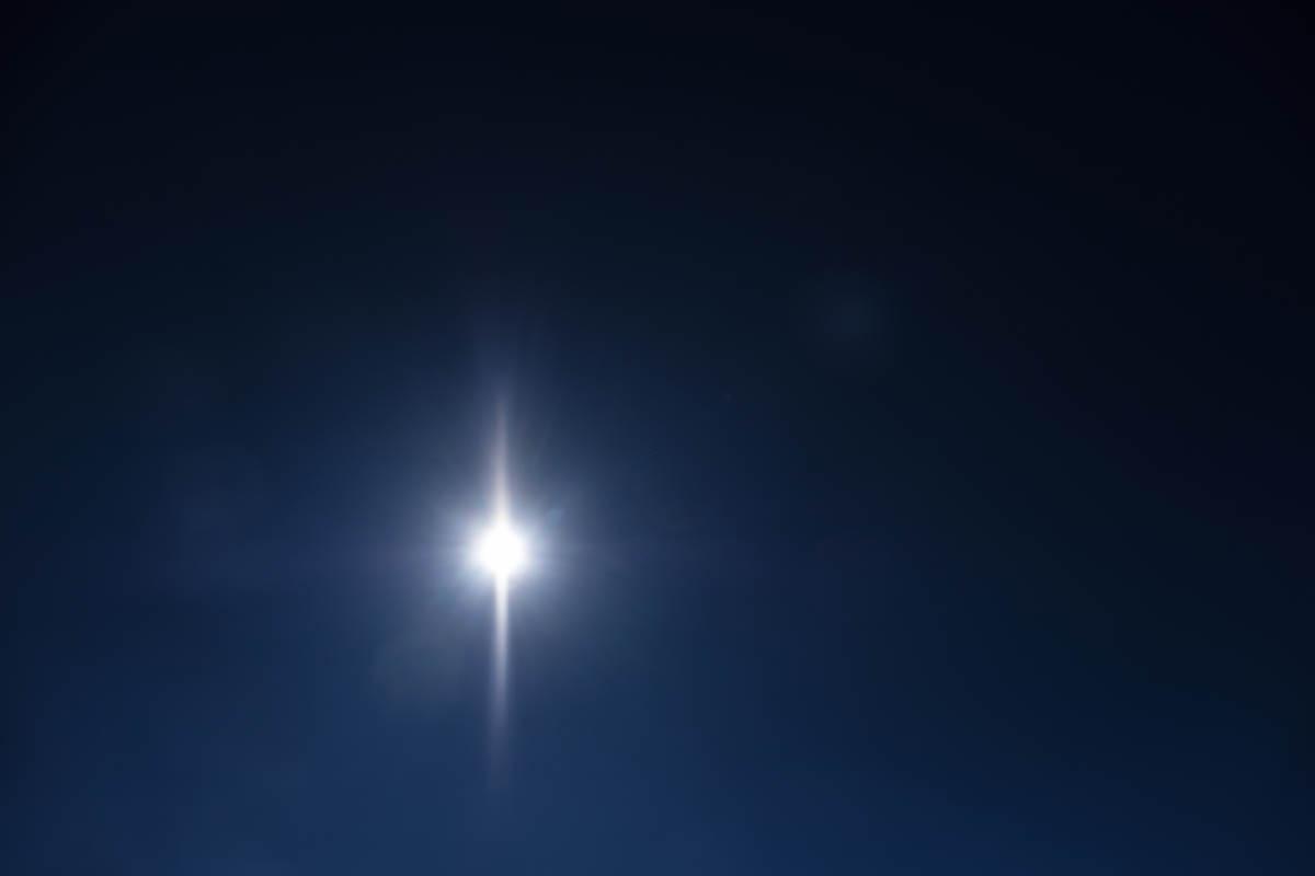 Free stock photo Star-burst view of sun shining in clear, dark blue sky