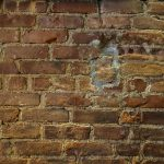 Free stock photo Full frame shot of damaged brick wall