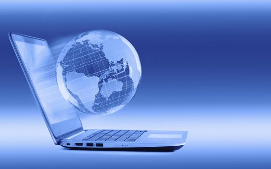 Free stock photo Laptop computer with globe emerging from the screen