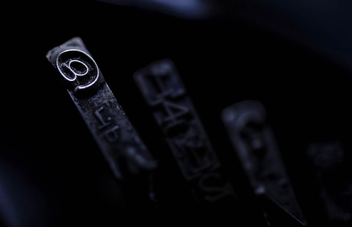 Free stock photo Close-up of 'at' symbol on typewriter key