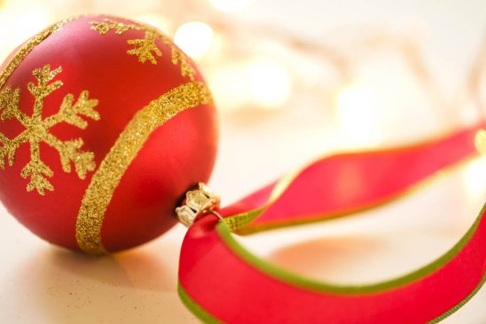 Free stock photo Close-up of red Christmas bauble with string