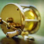 Free stock photo Close-up of antique brass fishing reel