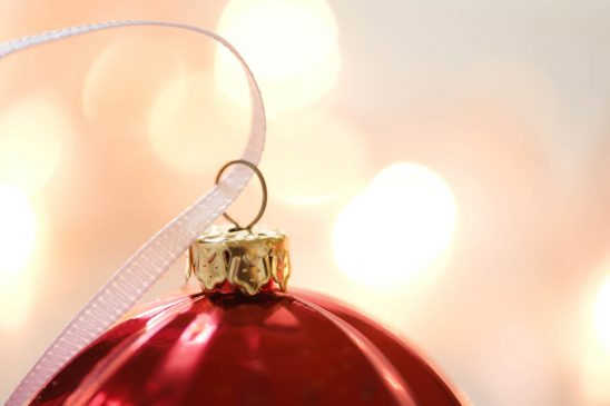 Free stock photo Close-up of ribbon on red Christmas ornament