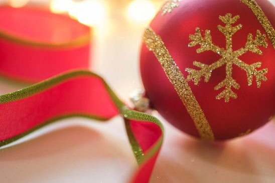 Free stock photo Close-up of red Christmas ornament and ribbon