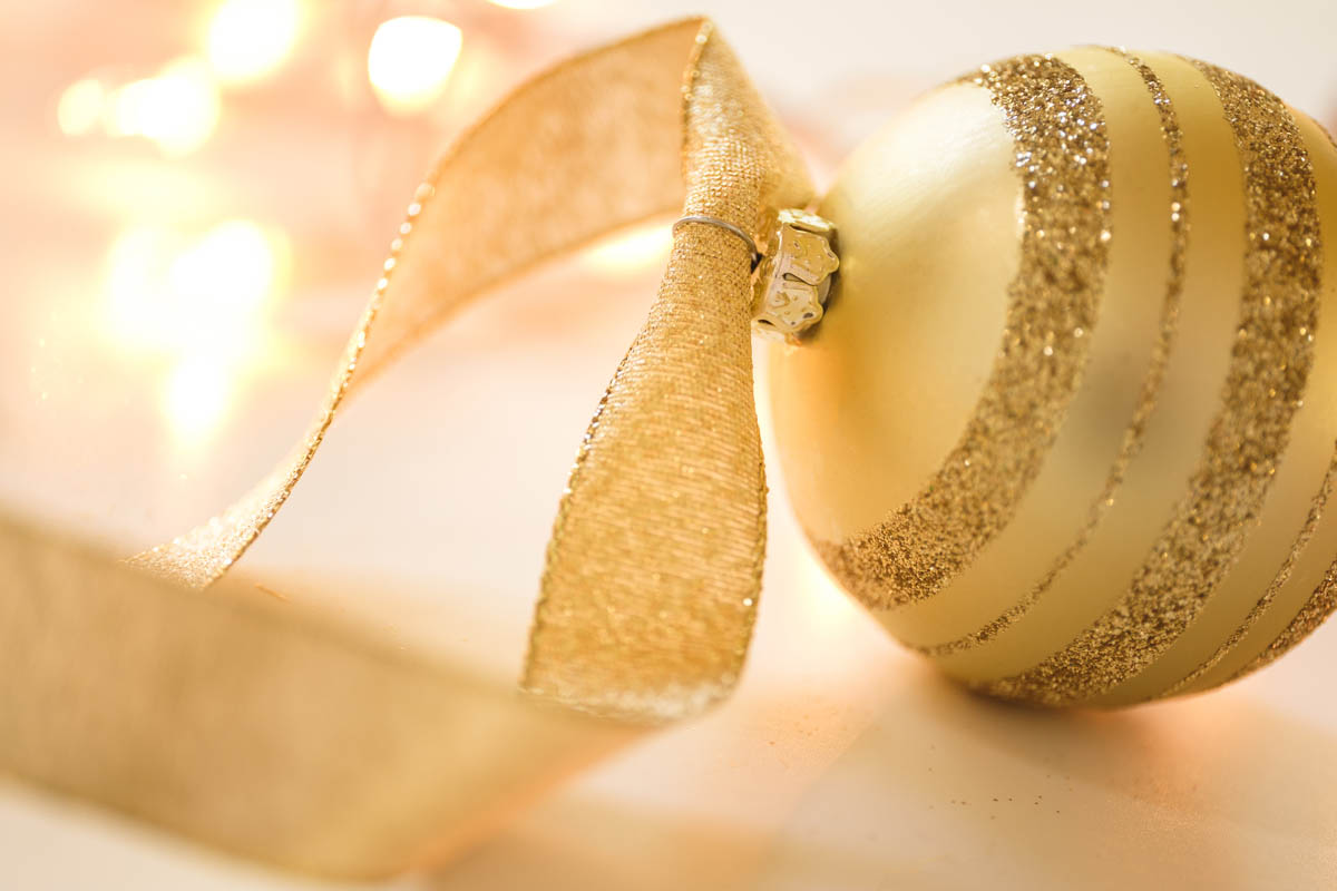 Free stock photo Close-up of gold colored Christmas ornament with designs