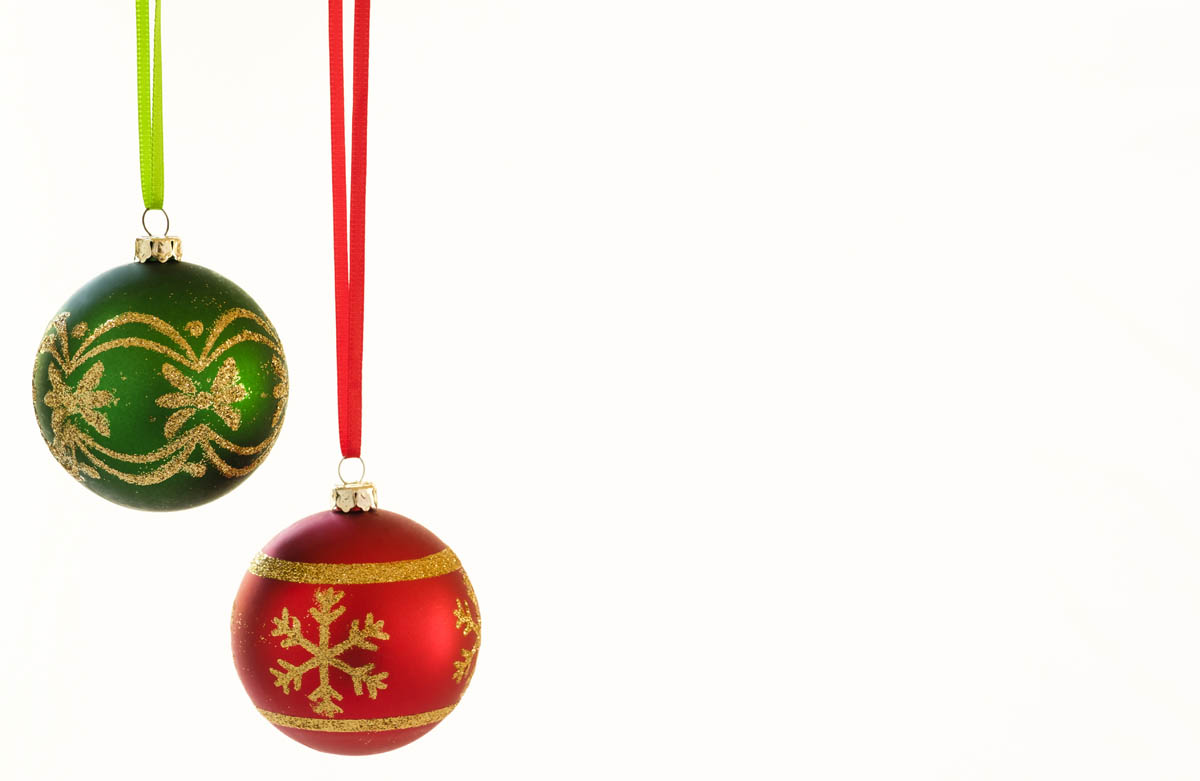 Free stock photo Close-up of green and red Christmas baubles over white background
