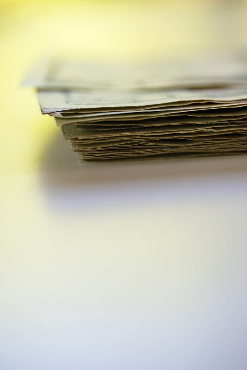 Free stock photo Stack of US currency with white space in foreground