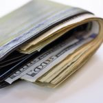 Free stock photo Close-up of American one hundred dollar bills in wallet