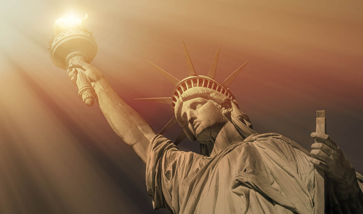 Free stock photo Low angle view of sunrays falling on Statue of Liberty