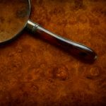 Free stock photo Close-up of an antique magnifying glass on table