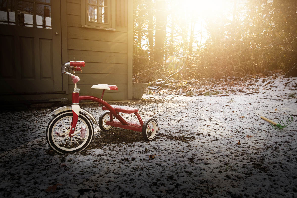 Free stock photo Red tricycle on snow covered yard