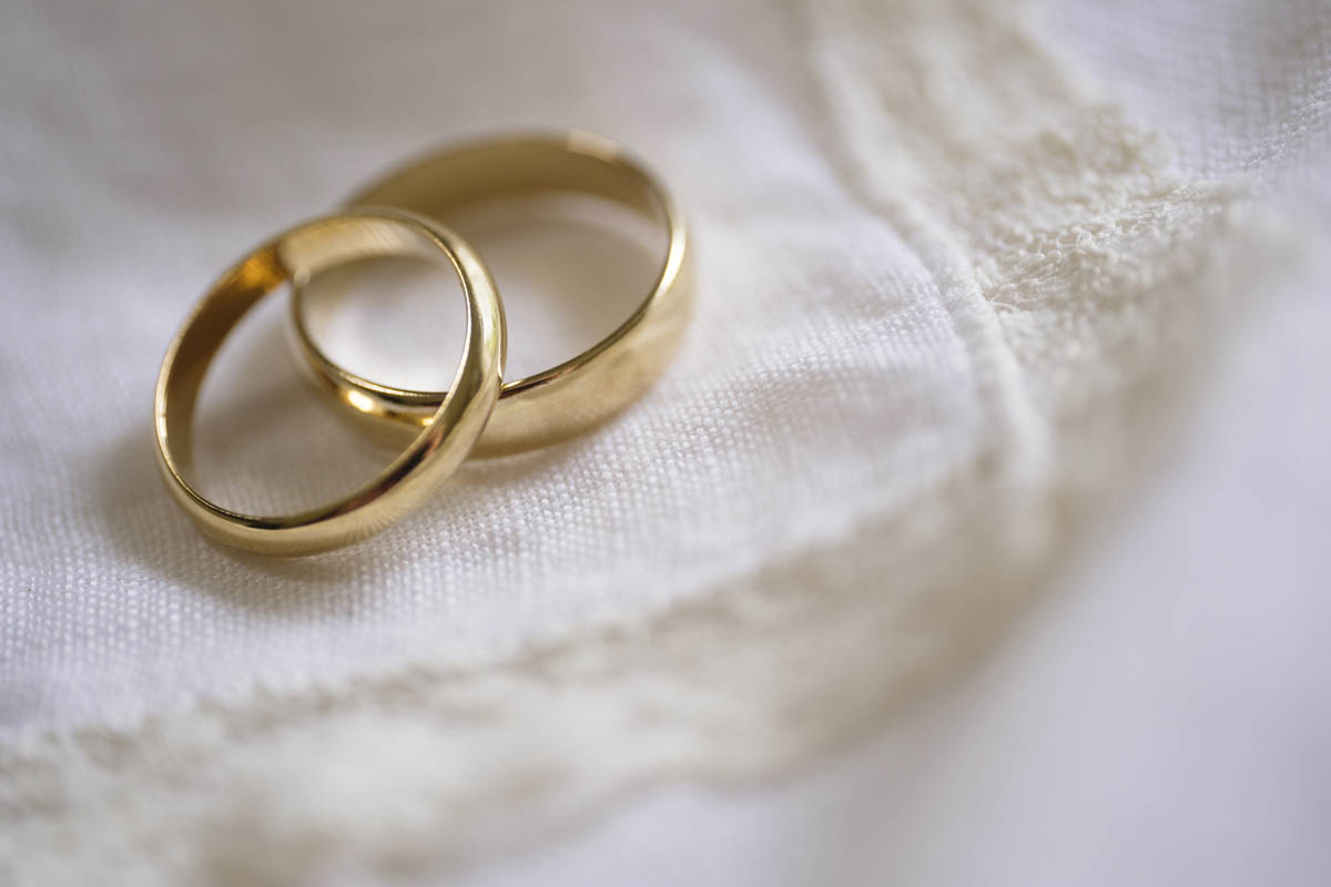 Free stock photo Close-up of engagement rings on fabric