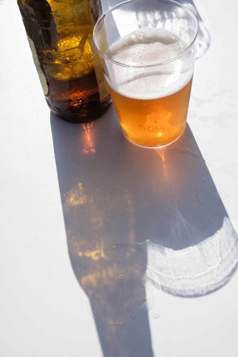 Free stock photo High angle view of beer bottle and glass on table