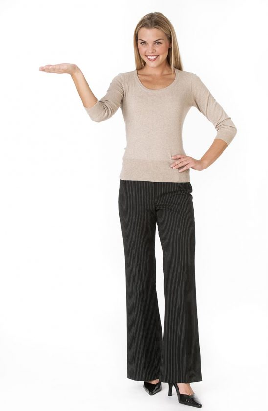 Free stock photo A young woman is standing with her arm outstretched while smiling at the camera